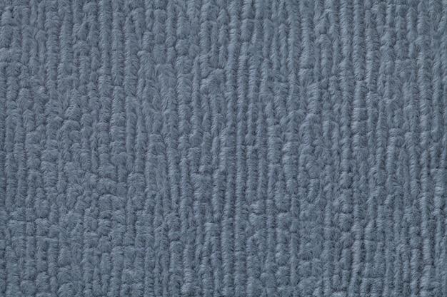 Темно-синий пушистый фон из мягкой, ворсистой ткани. текстура текстильной крупным планом