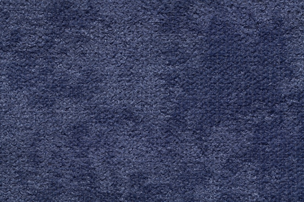 Navy blue fluffy soft, fleecy cloth. texture of textile closeup