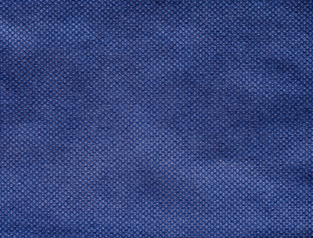 ネイビーブルー不織布またはスパンボンド生地のテクスチャ背景