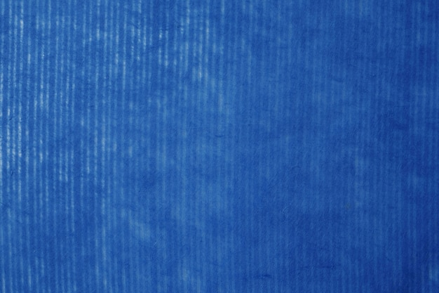Navy blue striped pattern on mulberry paper textured background, detail close-up