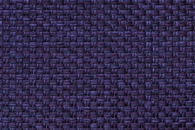 Navy blue textile background with checkered ,  structure of the fabric macro,