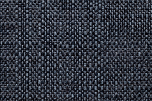 Navy blue textile with checkered pattern, closeup. structure of the fabric macro.