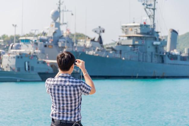 Navy harbor and warship or battleship at navy port