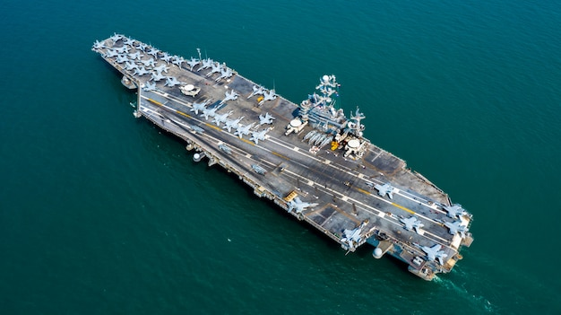 Navy nuclear aircraft carrier, military navy ship carrier full loading fighter jet aircraft, aerial view.