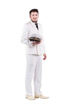 흰색 배경에 고립 된 드레스 흰색 유니폼에 웃는 해군 장교 남자
