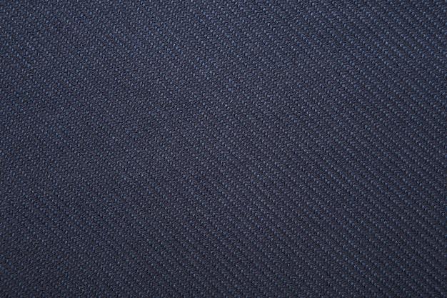 Темно-синий саржевого переплетения ткани узор текстуры крупным планом