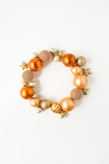 Nchristmas new year holiday composition. frame wreath with mock up copy space of ginger christmas baubles, balls and stars on white