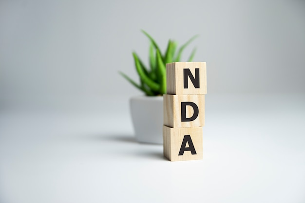 Nda non-disclosure agreement word on wooden cubes