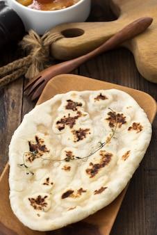 Ndian garlic naan bread on wooden