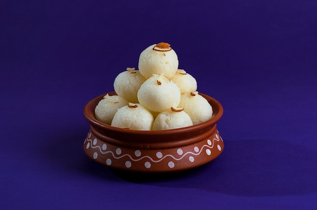 Ndian sweet or dessert - rasgulla in clay pot