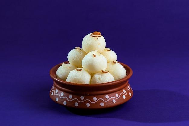 Ndian sweet or dessert - rasgulla in clay pot