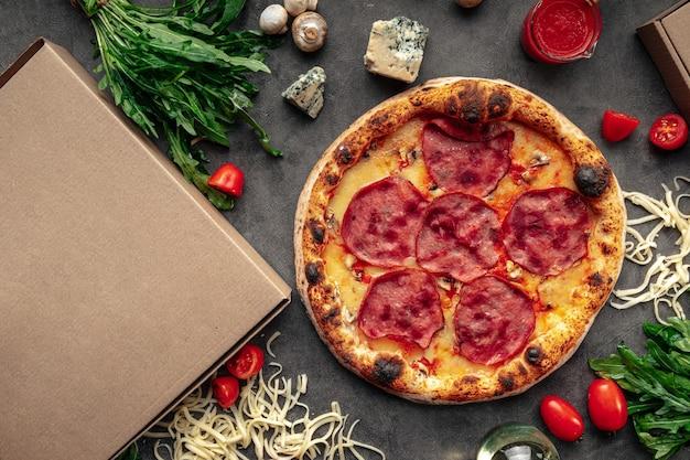 Neapolitan fresh baked ham pizza on grey