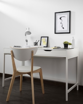 Neat and organised workspace with chair and lamp