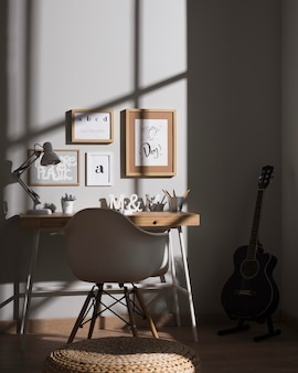 Neat and organised workspace with guitar