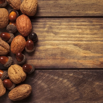 Neatly arranged autumn nuts on wooden table