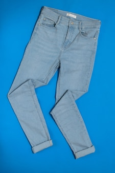 Neatly stacked on blue of women's jeans