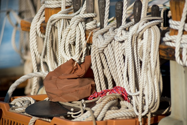 Neatly wound and stowed ropes on a sailboat