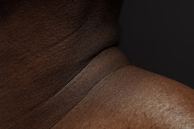 Neck. detailed texture of human skin. close up shot of young african-american male body. skincare, bodycare, healthcare, hygiene and medicine concept. looks beauty and well-kept. dermatology.
