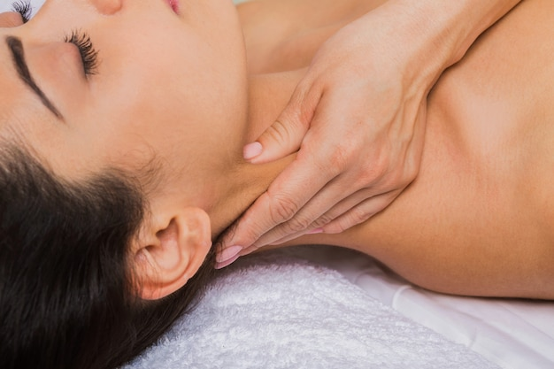 Neck massage in spa wellness center, closeup