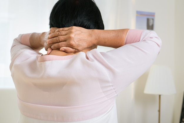 Neck and shoulder pain of old woman, healthcare problem of senior concept