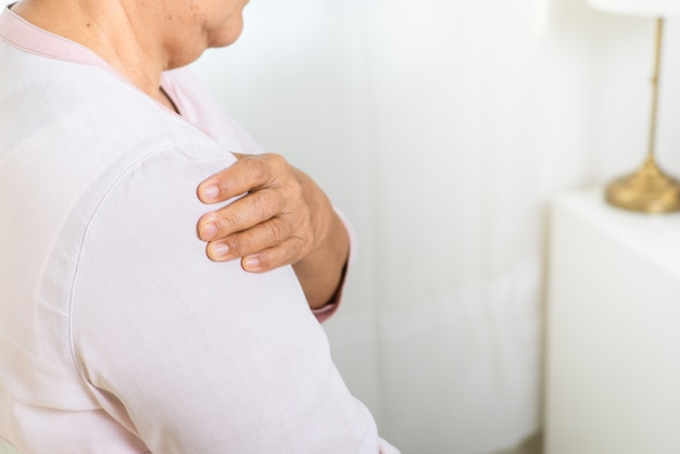 Neck and shoulder pain of old woman