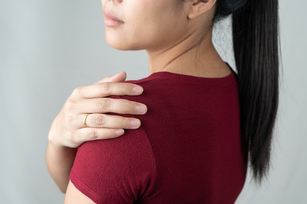 Neck and shoulder pain, young women injury, healthcare and medical concept