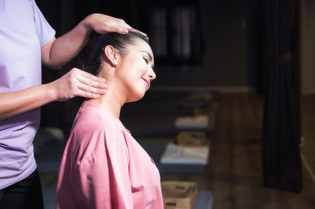 Neck thai massage to asian woman