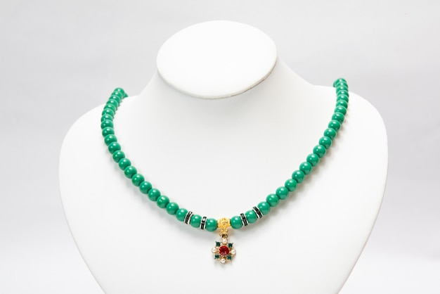 Necklace with green emerald stones.