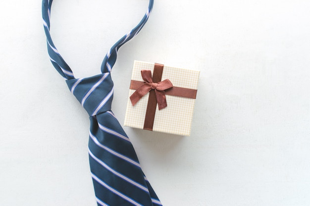 Necktie with gift view from above happy father's day inscription background concept.