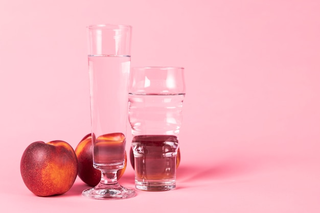 Nectarine fruit and glasses of water