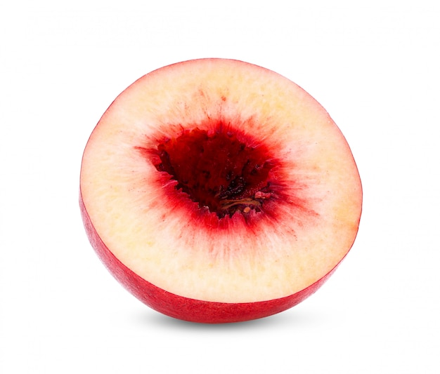 白い壁にネクタリンのフルーツ。