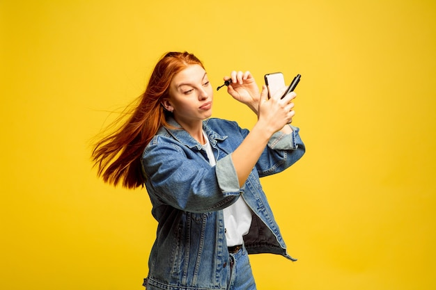 Need no selfie for make up. caucasian woman's portrait on yellow space