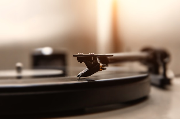 A needle playing an old vinyl. closeup view.
