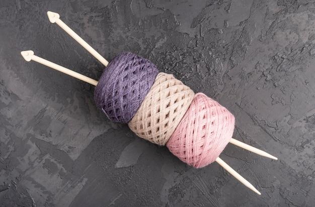 Needles and wool yarn on slate
