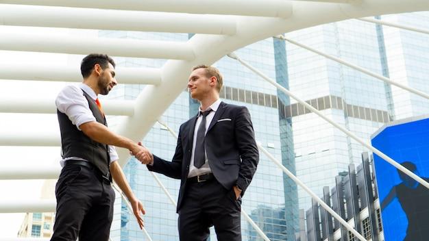 Negotiating business people handshaking, handshake gesturing people connection deal concep