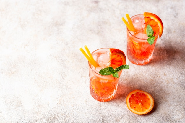 Negroni  cocktail with orange and ice