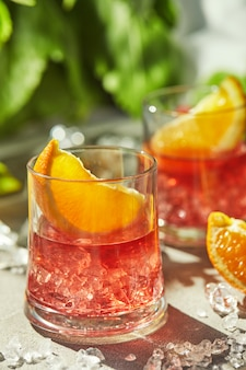 Negroni cocktails with slices of orange and ice