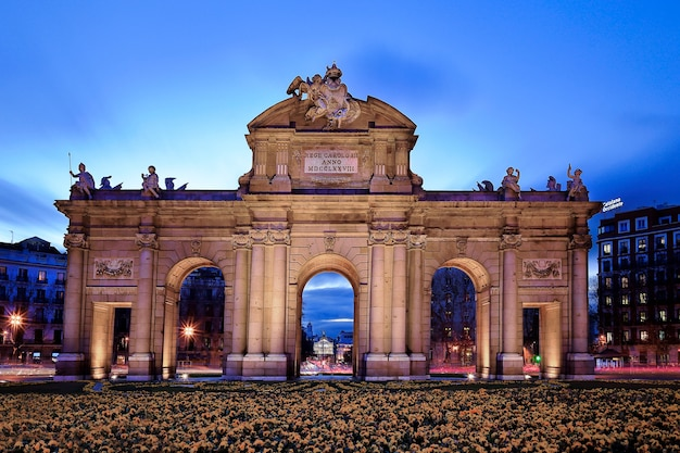 The neoclassical puerta de alcala in madrid is an ancient gate famous tourist and travel destination.