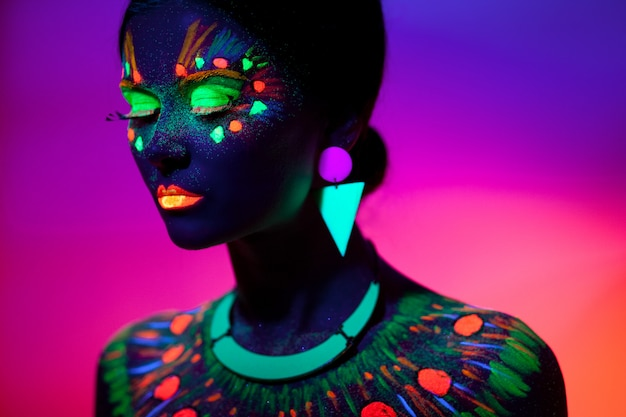 Neon beauty portrait of a young woman surrounded by abstract colours
