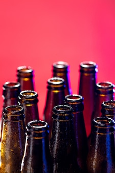 Neon colored beer bottles. close up on bright