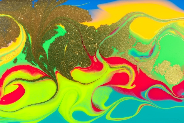Neon colored marble pattern with golden glitter. fluorescent liquid background. artwork abstract bright texture.