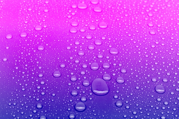 Neon colored water drops background