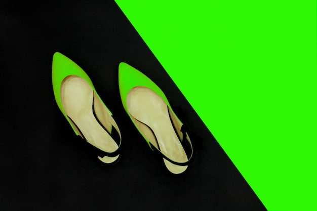 Neon green black summer shoes.