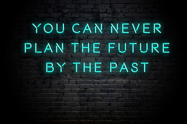 Neon inscription of positive wise motivational quote against brick wall