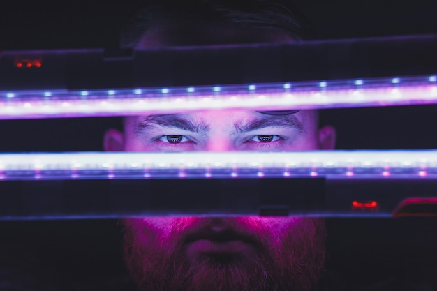 Neon light portrait of man model with mustaches