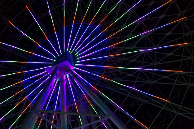 Neon lights on ferris wheel
