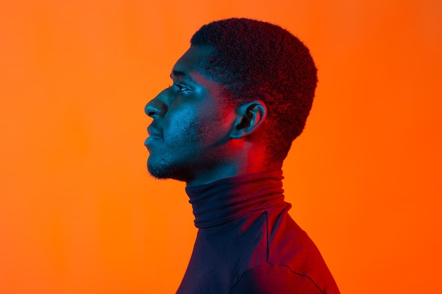 Neon portrait of young african american man, side view