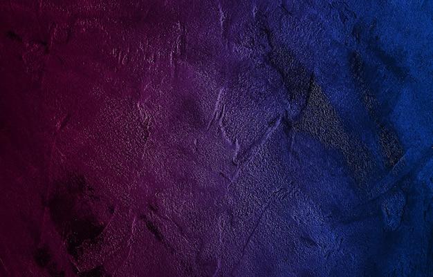 ネオンの壁のテクスチャの粗い背景が暗い。コンクリートの床または古いグランジの背景。