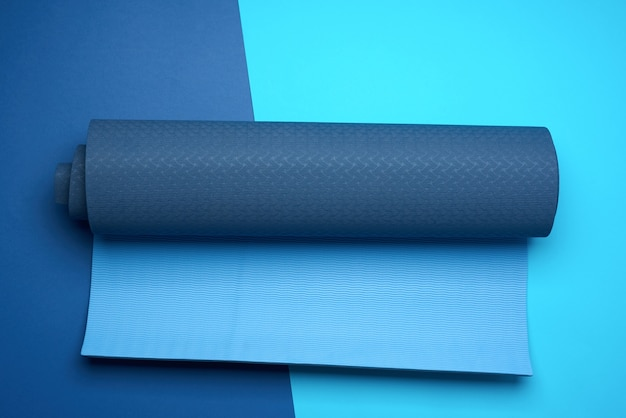 Neoprene blue twisted mat lies on a blue background