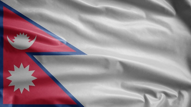 Nepalese flag waving on wind. nepal banner blowing, soft and smooth silk